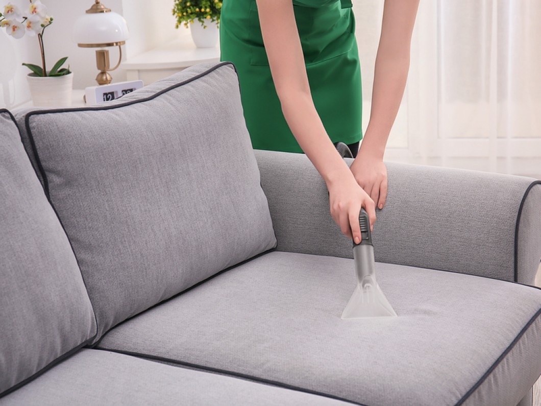 Woman Cleaning Couch Upholstery